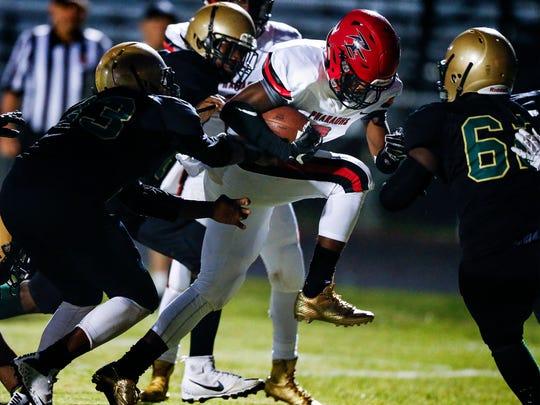 Raleigh-Egypt running back Kayln Grandberry (right)