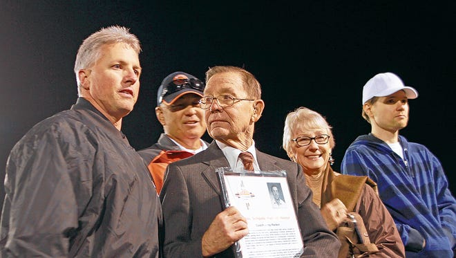 Aztec Municipal School District Superintendent Kirk Carpenter, left, presents Jerry Parker with a plaque on Sept. 28, 2013, during Aztec High School's Hall of Honor induction ceremony at Fred Cook Memorial Stadium in Aztec.