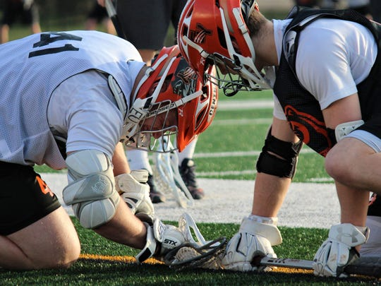Central York's Kollin Vaught, left, practices faceoff