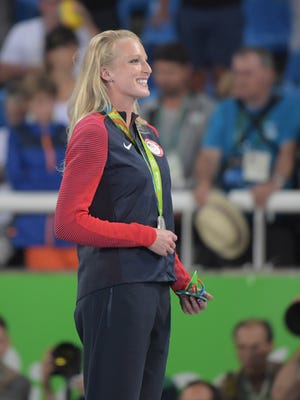 Aug 20, 2016; Rio de Janeiro, Brazil; Sandi Morris (USA) celebrates her sliver medal after the women's pole vault final during the Rio 2016 Summer Olympic Games at Estadio Olimpico Joao Havelange. Mandatory Credit: Kirby Lee-USA TODAY Sports