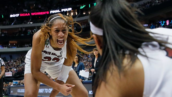 South Carolina forward A'ja Wilson (22) celebrates with teammate Allisha Gray (10) during the second half of an NCAA college basketball game against the Stanford in the semifinals of the women's Final Four, Friday, March 31, 2017, Friday, March 31, 2017, in Dallas. (AP Photo/Tony Gutierrez)