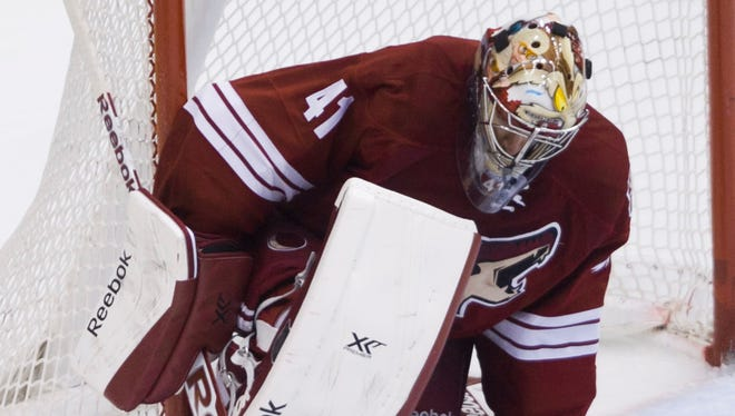 Coyotes' Mike Smith makes a save against the Blues in the first period at Jobing.com in Glendale, AZ on March 2, 2014.