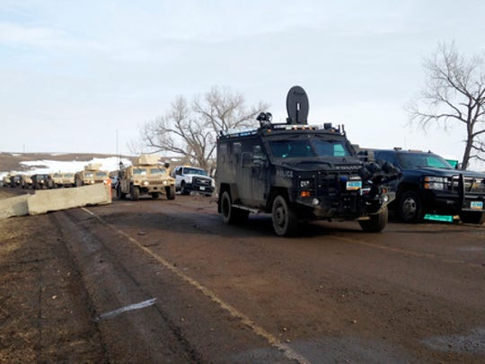Law enforcement vehicles arrive at the closed Dakota Access pipeline protest camp near Cannon Ball, N.D., Thursday, Feb. 23, 2017, where dozens of people remain. Most protesters left peacefully Wednesday when authorities closed the camp on Army Corps of Engineers land in advance of spring flooding, but some are refusing to go.