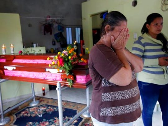 Luz Mary Ruiz cries next to the coffin containing the remains of her 26-year-old daughter Delcy Rosero Ruiz, a victim of a deadly avalanche that happened following heavy rains, in Mocoa, Colombia, Monday, April 3, 2017. The grim search continues for the missing in southern Colombia after surging rivers sent an avalanche of floodwaters, mud and debris through the small city, killing more than 260 people and leaving many more injured and homeless.