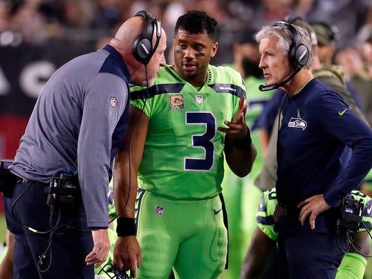 Seahawks quarterback Russell Wilson (3) speaks with