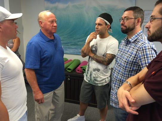 Peter Pisar speaks with members of the New Brunswick