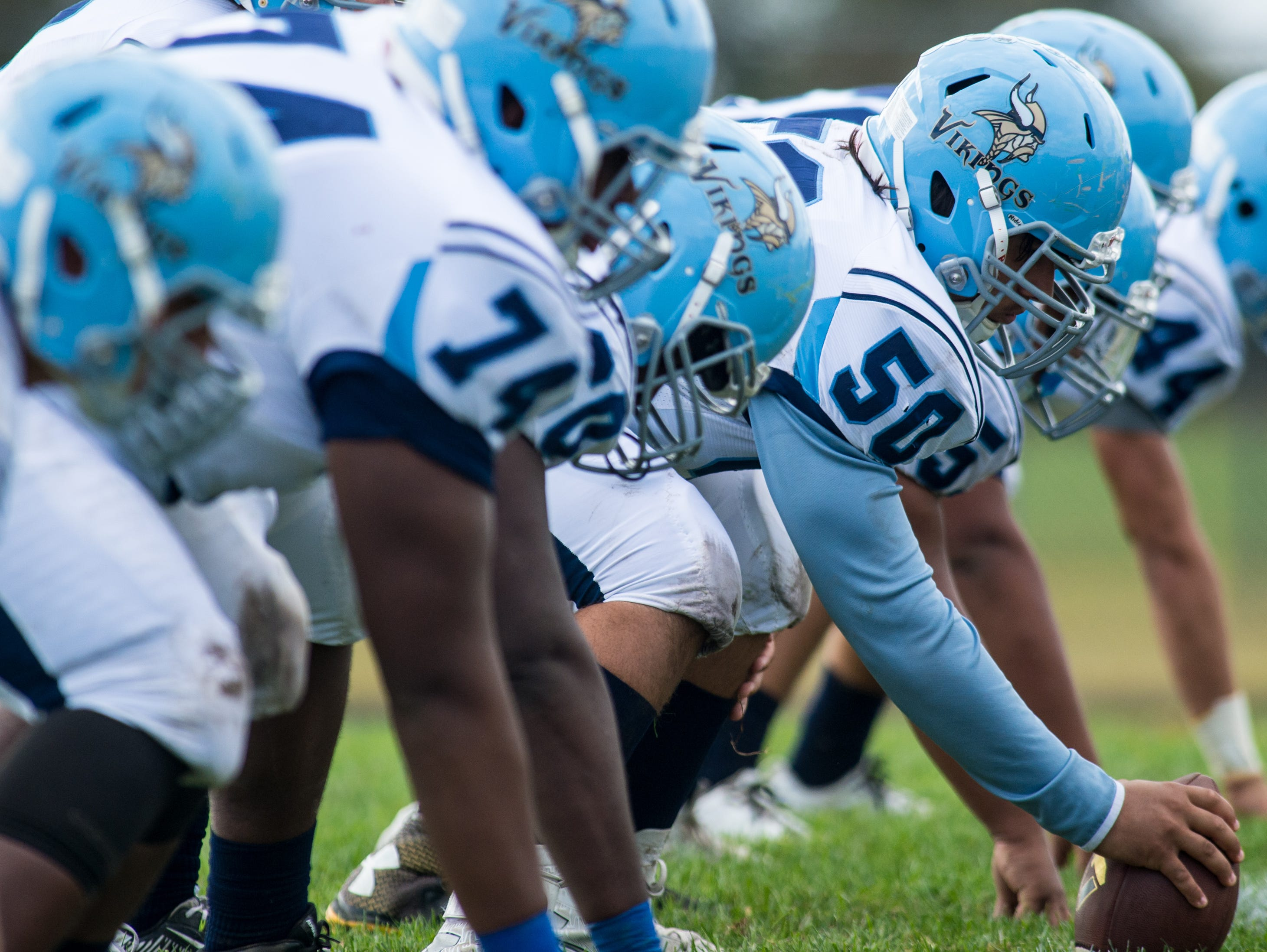 Cape Henlopen center Julian Medina (50) leads out the Viking offense against Sussex Central in Georgetown on Saturday, October 10th.