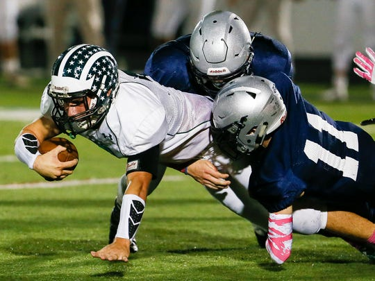Ridge's Dan Skea (7) stretches out for extra yardage against Immaculata in Somerville on October 14, 2016.