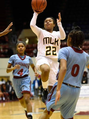 Detroit King guard Alicia Norman (22) puts up a shot against Detroit Mumford during the fourth quarter.