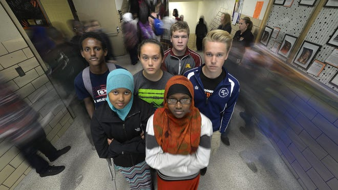 Hallway traffic bustles around St. Cloud Tech students from left: Muftah Saney, Fadumo Hassan, Whitney Holm, Drew Erickson, Ethan Gray, and Rukiyo Hussein, front, Wednesday near the lunch room. As students head to classes, the hallway and stairs become almost impassable with the volume of students.