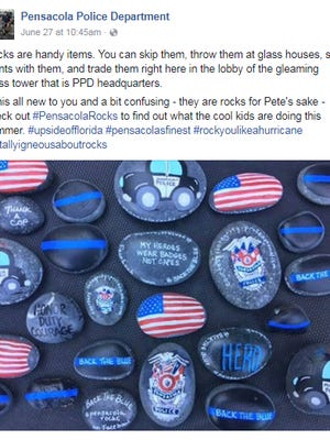 The Pensacola Police Department share a post on their Facebook featuring Pensacola Rocks painted at the PPD headquarters.