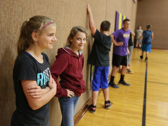 Seventh-grader Sophie Davis, left, and fifth-grader Malory Drill participate in a P.E. class on Wednesday, May 18, 2016, at the Falls City High School gym. Elementary and middle school students are bussed to the high school twice a week for P.E. classes.