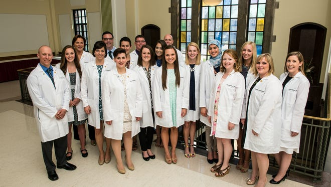 Eastern Michigan University's first physician's assistant class, which graduated this spring. Several members hail from western Wayne and western Oakland counties.