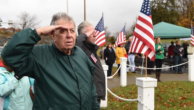 Retired Army Sgt. George Kennedy, a Vietnam veteran from Beekman, salutes during the Pledge of Allegiance at the 2015 Dutchess County Veterans Day ceremony held at the Dutchess County War Memorial in the Town of Poughkeepsie.