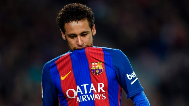 Barcelona forward Neymar biting on his jersey  during the Spanish league football match FC Barcelona vs Valencia CF.