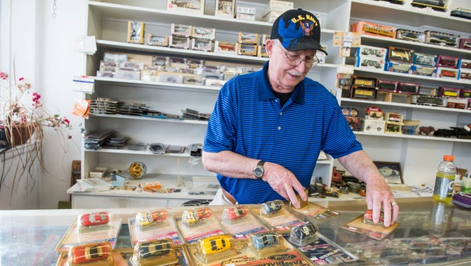 Jack Hooks, an owner at Thomasville Country Auction, organizes merchandise at Strickler's Hobby House in Hanover on May 10, 2018. An auction for all of Strickler's merchandise (and more) will be held June 4 and 6 at the auction house at 5250 Lincoln Highway, Thomasville.