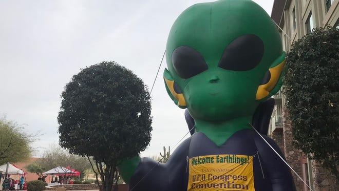 A giant blow-up alien greets visitors at the International UFO Congress on Saturday, Feb. 17, 2018.