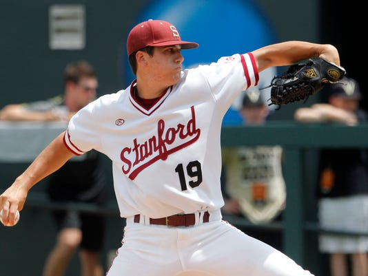 In this Saturday, June 7, 2014 photo, Stanford pitcher Cal Quantrill throws to a Vanderbilt batter during the first inning of an NCAA college baseball Super Regional tournament game in Nashville, Tenn. The scouts expect Quantrill to be a first-round draft pick in June 2016, perhaps in the top 10, even if he doesn't pitch in a college game until April or May. (AP Photo/Wade Payne, File)