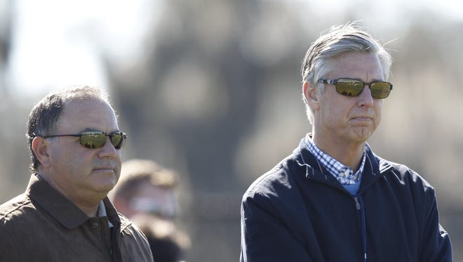 Detroit Tigers assistant GM Al Avila, left, and GM Dave Dombrowski watch spring training Feb. 14, 2014.