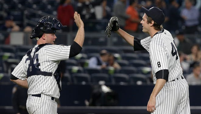 Yankees catcher Brian McCann, left, greets pitcher Andrew Miller after the Yankees defeated the Tampa Bay Rays 6-3 on Friday, April 22, 2016, in New York.