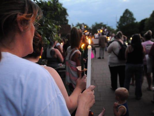 01 CGO candlelight vigil