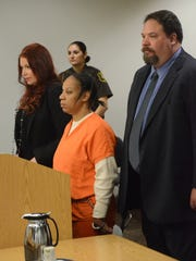Cheryl White is flanked by her attorneys, Kimberly and Jeffrey Schroder, in court on Tuesday.