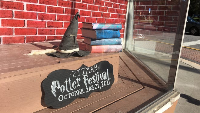 A window formerly of Bob's Hobbies is decorated to advertise Pitman Potter Festival Oct. 21.