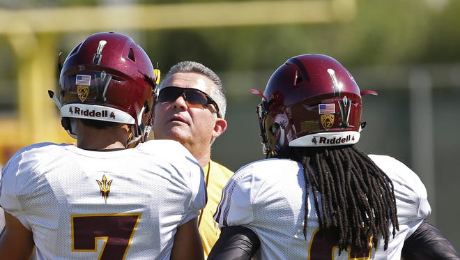 ASU coach Todd Graham talks with players during an outdoor practice at ASU on August 15, 2016 in Tempe.