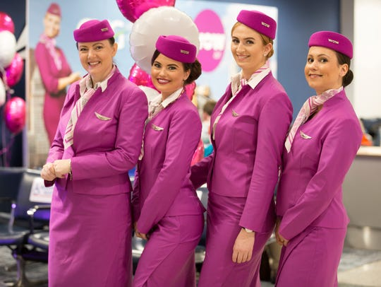WOW flight attendant's uniforms embrace a vintage look from the glamorous golden age of Pan Am from the 1960's.