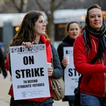 Chicago Public School teachers Tammie Vinson, left, and Katie Sciarine, right, both of Oscar DePriest School, load signs in their vehicles on March 30, 2016 in preparation for Friday's one-day teachers strike in Chicago.