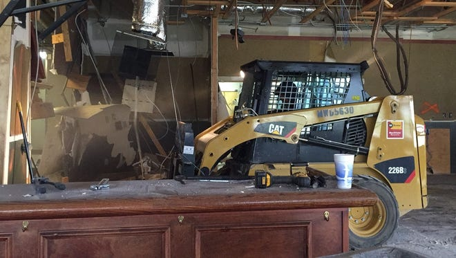 Ron Bullock of Shook Construction uses a skid steer loader to do demolition inside the former Ruby Tuesday restaurant on West Eaton Pike in Richmond. Reid Health converted the building into physicians' office space.