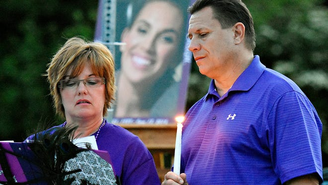 Crystal Strous, left, is supported by her husband Eric Strous as she speaks during a candlelight vigil held in honor of their daughter Amanda Kay Strous, a former Dallastown High School graduate, at their home in York Township, Monday, June 20, 2016. Amanda was a victim of homicide Saturday, according to police in North Carolina, where she currently lived. Dawn J. Sagert photo