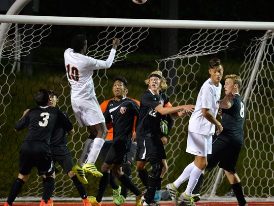Rocori players crowd the goal to try to protect against
