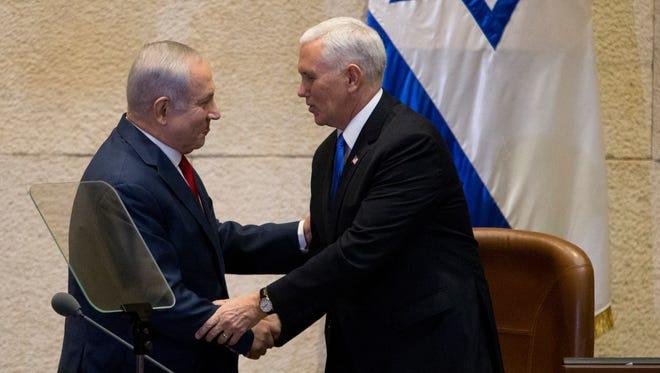 Israel's Prime Minister Benjamin Netanyahu, left, shake hands with U.S. Vice President Mike Pence in Israel's parliament in Jerusalem, Monday, Jan. 22, 2018.