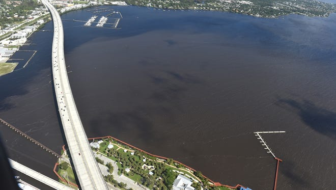 Brown water, rainfall runoff  from western Martin and St. Lucie counties, and Lake Okeechobee discharges, is seen in the Indian River Lagoon and flowing out into the ocean on Wednesday, Oct. 11, 2017, along Martin and St. Lucie counties.