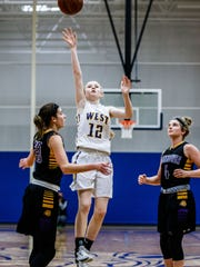 New Berlin West sophomore Megan Kosidowski (12) elevates