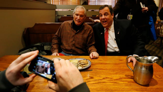 Gov. Chris Christie takes a photo with Greg Theroux of Waukee Saturday Jan. 16, 2016 as the Republican presidential candidate greets the breakfast crowd at the Machine Shed Restaurant in Urbandale, Iowa.