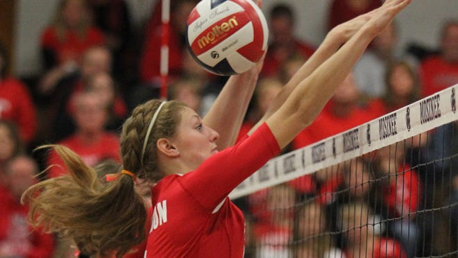 Emily Kind blocks as the Raiders beat Auburndale in 5 sets at Mosinee, Thursday, October 30, 2014.