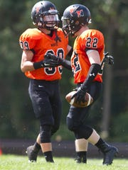 Middletown North's Marc Cerbo (39) celebrates a touchdown by Connor Welsh (22). Middletown North vs Marlboro football.
