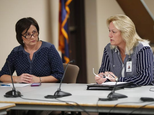 Scottsdale Unified School District board President Barbara Perleberg (left) listens to Superintendent Denise Birdwell during a governing board meeting Jan. 30, 2018. The board accepted the resignation of former CFO Laura Smith, who resigned after payments to a company she had ties with were reported.