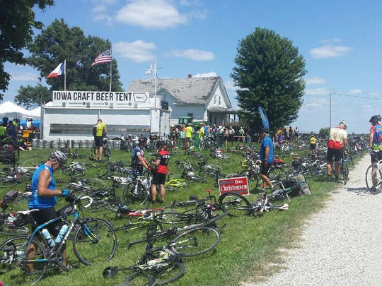 RAGBRAI rideras gather at the Iowa Craft Beer Tent in rural Leon on Tuesday.
