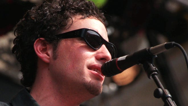 Jakob Dylan of The Wallflowers performs for the crowd gathered in RFK Stadium in Washington for the June 14, 1998, Tibetan Freedom Festival.