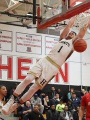 BJ Saliba of Hackensack dunks the ball in the second  half of a Bergen Jamboree game against Ridgefield Park on Saturday, Feb. 3, 2018.