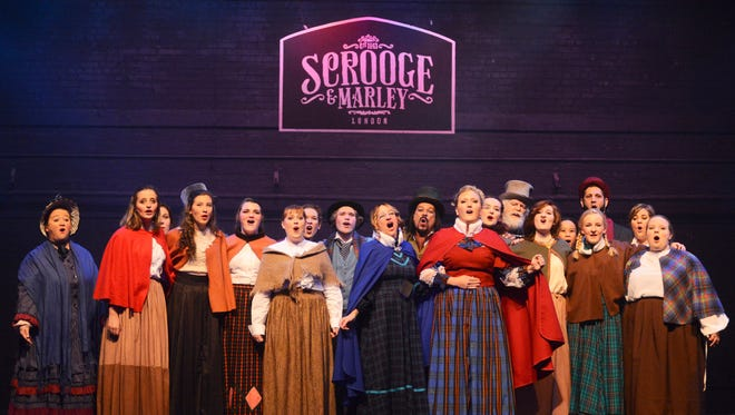 Members of the cast of HCLO's A Christmas Carol rehearse on Tuesday night at the Saenger Theater. The production debuts on Thursday night. /Mary Alice Truitt