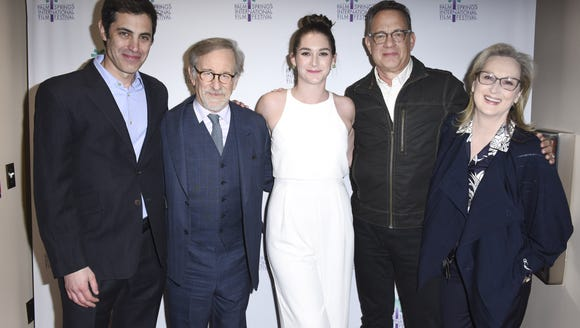 Liz Hannah poses with her 'The Post' team: co-writer