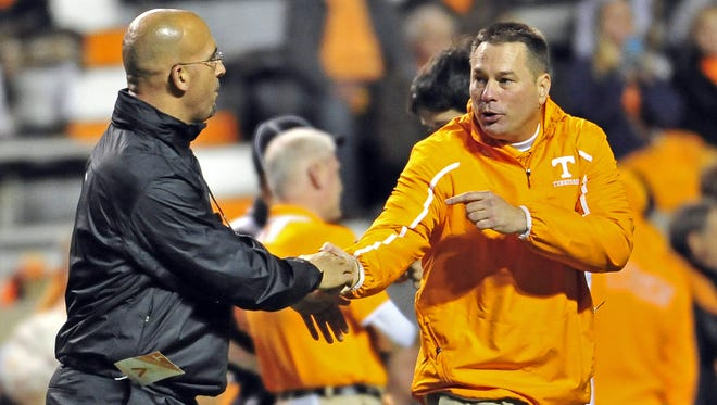 Vanderbilt coach James Franklin, left, shakes a hand with Tennessee coach Butch Jones before the Commodores win over the Vols in 2013.