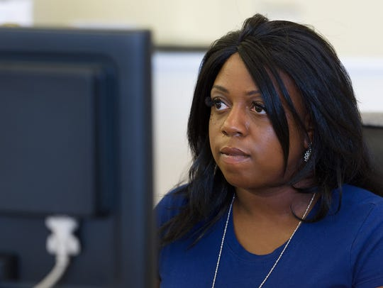 Ronkesha Mullen works at Atlantic Finance, a payday