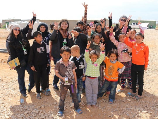 On the last day of the visit, volunteers from PACE and Humanitarian Family Aid share a symbol of hope with some of the Jordan refugee camp's children.