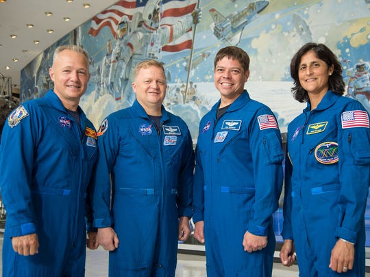 "Doug Hurley, from left, Eric Boe, Bob Behnken and Sunita ""Suni"" Williams have been selected to be the first astronauts to train for test flights to the International Space Station on Boeing's CST-100 Starliner and SpaceX's Crew Dragon. Standing at Johnson Space Center in Houston, training base for NASA's astronaut corps, the crew posed together for the first time in July 2015."