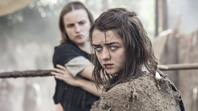 Arya Stark (Maisie Williams), right, now blind, is taught a fighting lesson by the Waif (Faye Marsay) in HBO's 'Game of Thrones.'